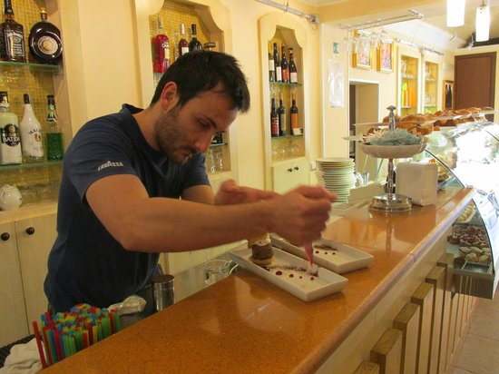 Grand Caffe Florio: Pastry Chef putting his creative touch on the dessert