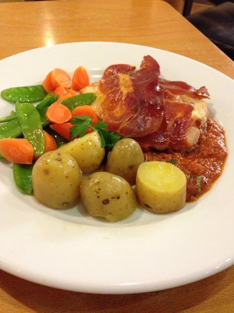 Butterflied chicken with crispy Parma ham served on a tomato & basil sauce with 3 cheeses