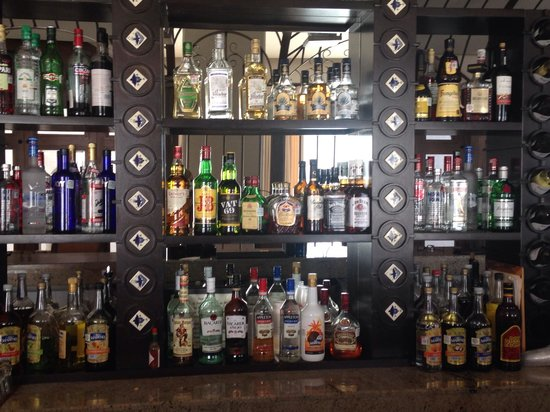 Secrets Puerto Los Cabos Golf & Spa Resort: Drink selection at main bar