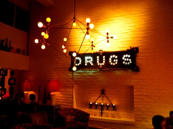 Parker Palm Springs: lobby. The drugs sign is actually an antique sign from an old pharmacy!