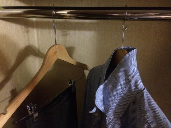 Holiday Inn Plattsburgh: Do you really think that I am going to steal your hangers???? Jeeesh.  What is this? A dolly dim