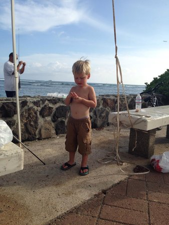 Ala Moana Beach Park: Fun in the sun, eating fish we caught right off the shore!