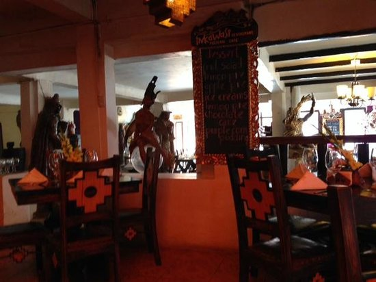 Inka Wasi Restaurant and Pizzeria: inside a little dark at noon. few small sidewalk tables with brighter light