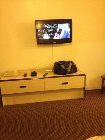 Portal Motel : Cabinet, flat screen tv on wall.
