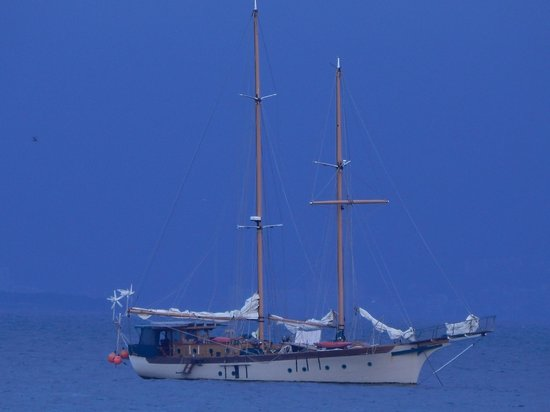 Eva`s Brickhouse: Majestic yacht anchored abot a mile out from Eva's Brickhoue