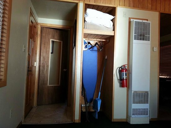 Zephyr Cove Resort : mirror on bathroom door with standing shower inside, iron and iron board.. pillow, etc.
