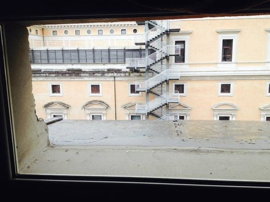 "Welcome Piram Hotel : view through so called ""window"""