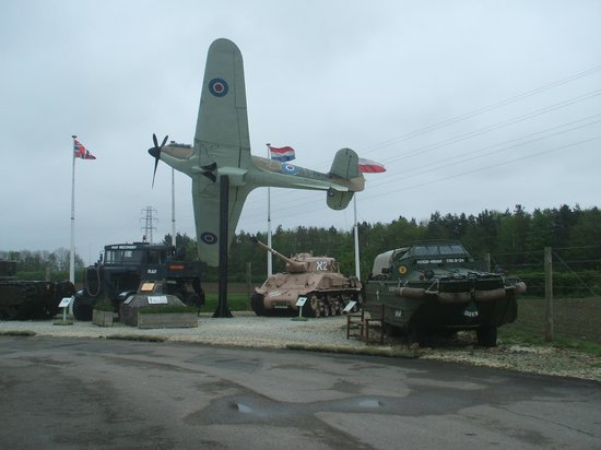 Eden Camp: picture of a spitfire and tanks