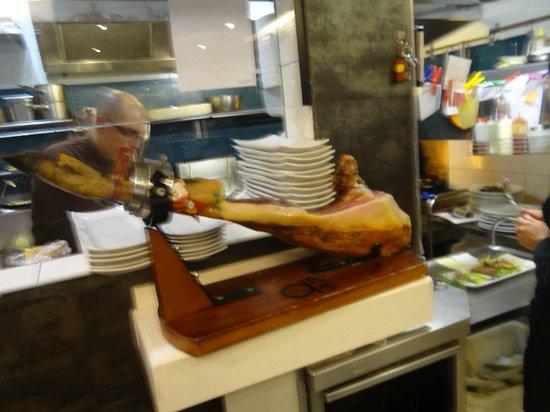 La Azotea Gran Poder: Iberico Ham, observe the high octane in the small kitchen.