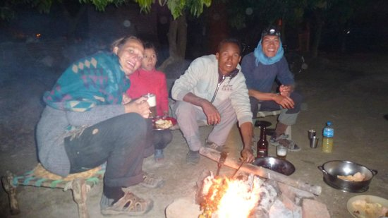 Campfire barbeque at homestay with Sonja (left) and Budhi (right)