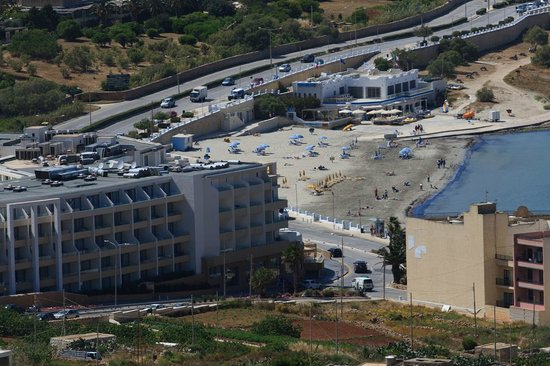 db Seabank Resort + Spa: The hotel and the beach, view from Melieha town
