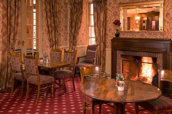 Carfraemill: Roaring fire in our Bistro restaurant area: all set up for Sunday lunch