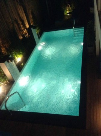 BYD Lofts Boutique Hotel & Serviced Apartments: View from #204 apartment to pool area (night time)