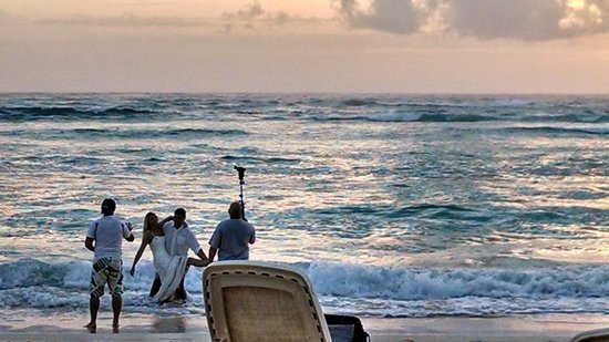 Majestic Colonial Punta Cana: a couple getting their wedding photos done at sunrise