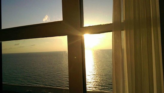 Miami Beach Resort and Spa: Sunrise over the ocean from my bed
