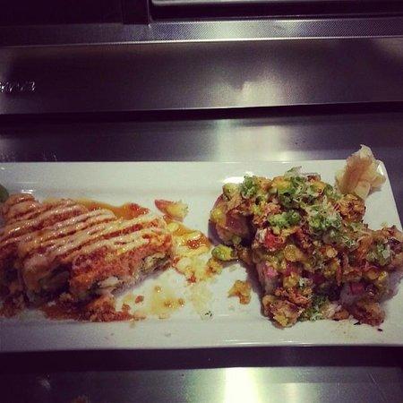 Tsunami Sushi Bar. Wok & Grill