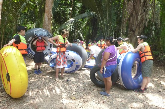 Belize Cave Tubing: hour of walking with tube, getting ready for water