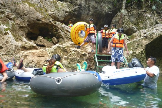 Belize Cave Tubing: Getting all tied up, Boarding tubes.