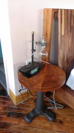 The Paper Factory Hotel : Side table, clock radio, lamp