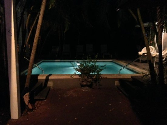 Ambrosia Key West Tropical Lodging: View of square pool at night looking from lap pool area