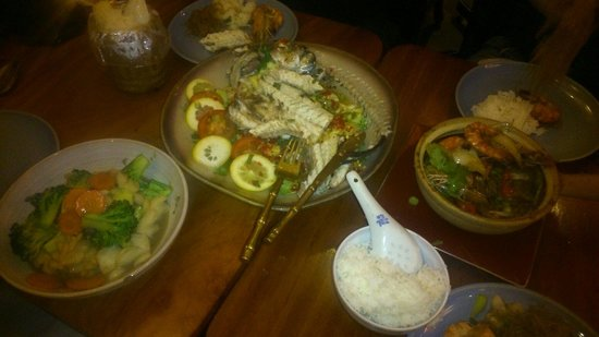 Bangkok Bay Battersea: From left to right: squid with broccoli in oyster & soy sauce, steamed whole seabass and prawn h