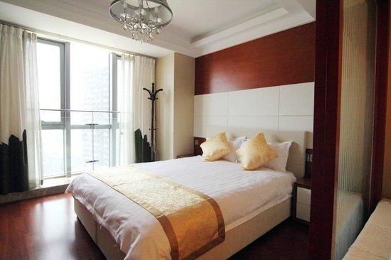 Youlemei Apartment Hotel Chongqing Xiexin: 卧室