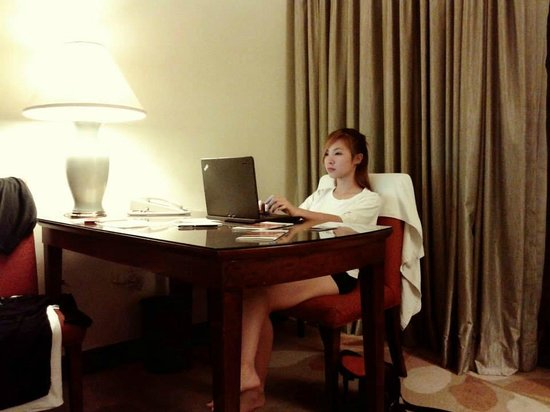 Marco Polo Davao: that's me on the desk inside our room