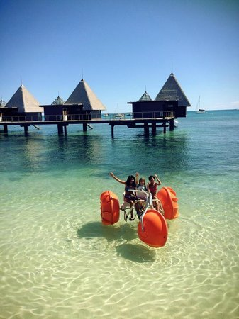 L'Escapade Island Resort: Kids on Pédalo with Water Bungalow Background
