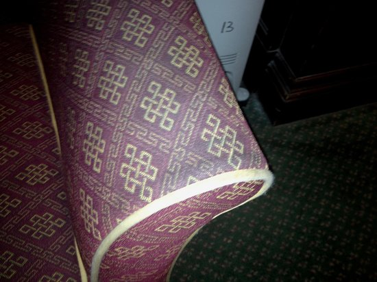 The Palace Hotel: Dirty upholstery in room