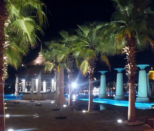 Anantara The Palm Dubai Resort: view over the pool area at night