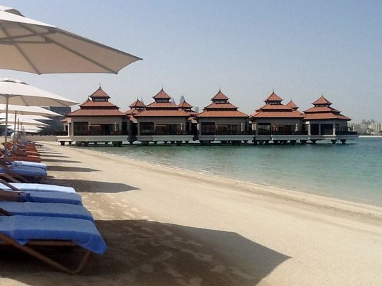 Anantara The Palm Dubai Resort: view from the beach towards the over water chalets