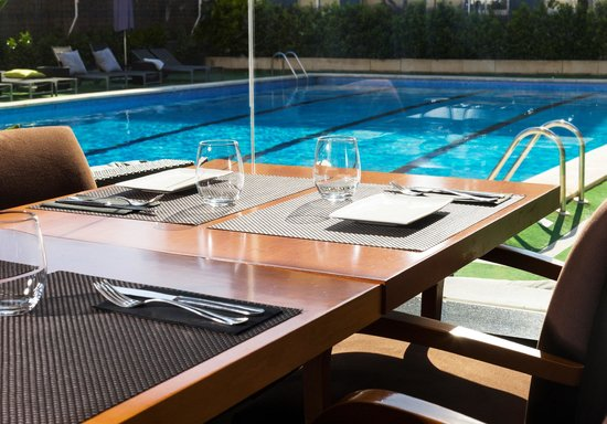 Astari Hotel: Restaurant vista piscina