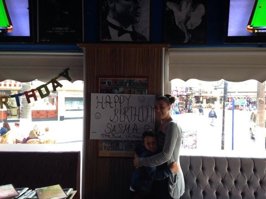Murphy's Restaurant & Bar: Me and my brother with the banner they made me x