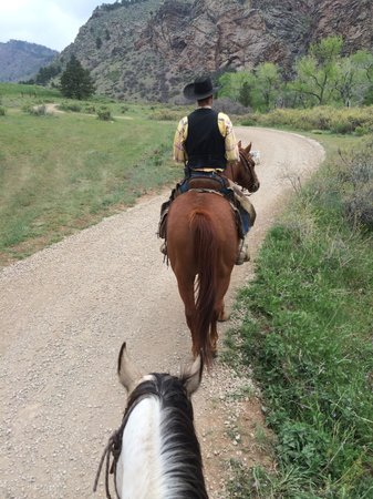 Sylvan Dale Guest Ranch: Heading off on my horse, Cowboy, following our wrangler, Slim.
