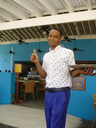 Iberostar Grand Hotel Rose Hall: Our friendly waiter at Chris' Restaurant - breakfast here every morning....
