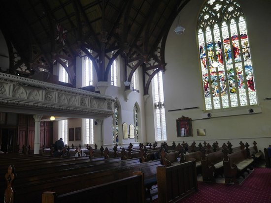 First Church of Otago: Wooden beams and stained glass interior