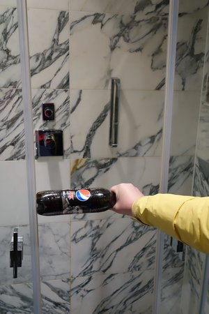 The Kensington: The shower door fully opened - barely more than a bottle of soda