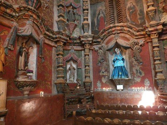 Mission San Xavier del Bac : Side transcept with votive candles.