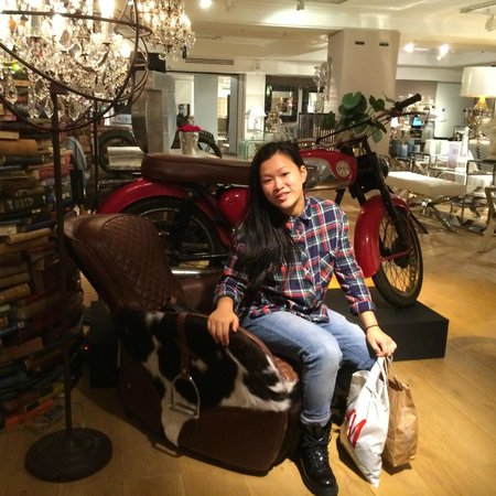 Harrods: resting on cowhide chair