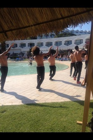 SENTIDO Phenicia: Boys with there tops off :) doing a show by the pool for new arrivals :)