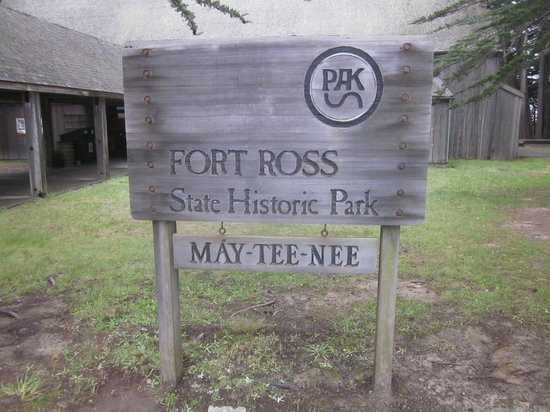 """Fort Ross State Historic Park: Entrance sign with """"Native American Name at the bottom"""""""