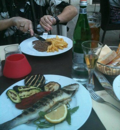 Trattoria In Campieo: Second course: My hubby had steak and I had the fish