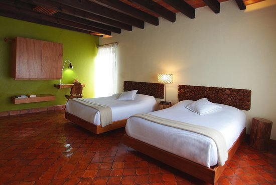 Casa Fernanda Hotel Boutique: Junior suite con dos camas.