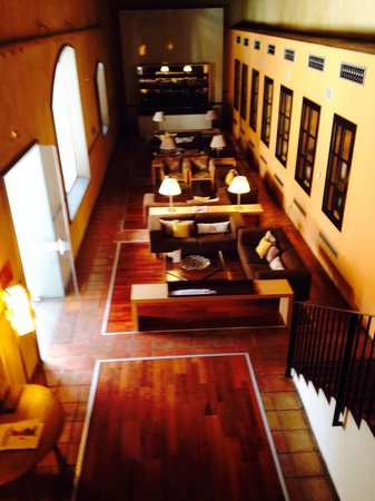 AC Palacio De Santa Paula, Autograph Collection: Hi ceilings add to the very open, spacious feeling of this hotel. This is a view of an indoor si