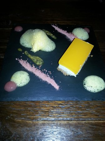 The Atelier Restaurant: passionfruit cheesecake with mango mousse