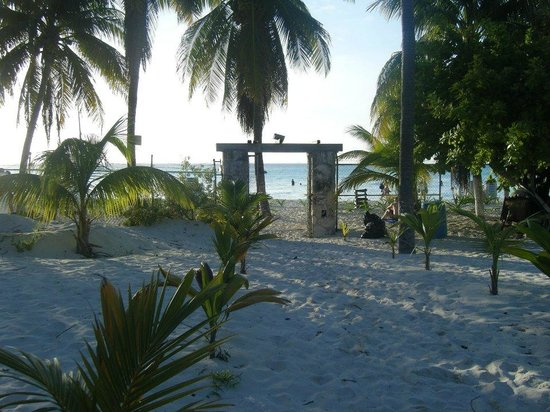 Cabanas Maria Del Mar: The beach is just a short walk through the hotel grounds (this gate does lock at a certain time)