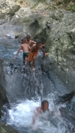 """Makaira Resort : Some local kids at the natural water slide. """"laco telly"""" (sp?) means """"do it again!"""" in Fijian"""