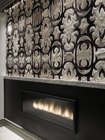 Hilton Dallas Park Cities: Artisitc Leather and Hide Design above Fireplace