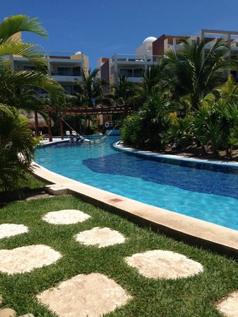 Excellence Playa Mujeres : lazy river pool near spa.  Nice little outdoor rooms here w couch.