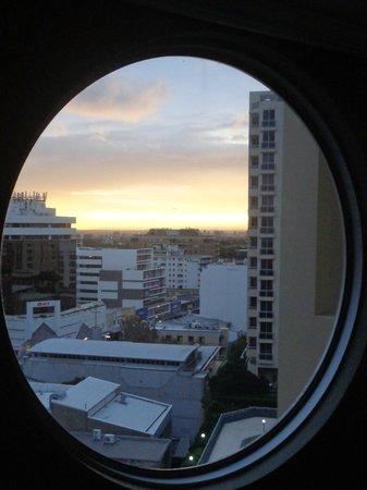 Meriton Serviced Apartments Bondi Junction : View through round window in LR/Dining Room